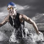 Triathlete Running Out of Lake